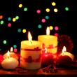 Beautiful candles on wooden table on bright background — Stock Photo