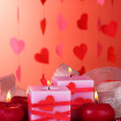Royalty-Free Stock Photo: Candles for Valentine\'s Day on wooden table on red background