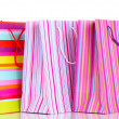 Colorful gift bags isolated on white — Stock Photo