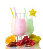 Milk shakes with fruits isolated on white — Stock Photo