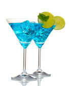 Blue cocktail in martini glasses with ice isolated on white — Stock Photo