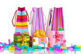 Colorful gift bags and gifts with serpentine isolated on white — Stok fotoğraf