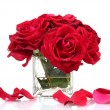 Beautiful bouquet of red roses in vase isolated on white — Stock fotografie