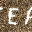 Word tea made of dry leaves closeup — Stock Photo