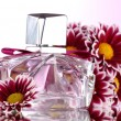 Women's perfume in beautiful bottle and flowers isolated on white — Stock Photo