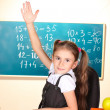 Little schoolchild in classroom near blackboard — Stock Photo #9055944