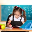 Little schoolchild in classroom near blackboard — Stock Photo #9055947