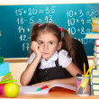 Little schoolchild in classroom near blackboard — Stock Photo #9055953