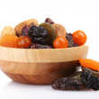 Dried fruits in wooden bowl isolated on white — Stock Photo