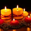 Beautiful candles and decor on wooden table on black background — Stock Photo #9056538