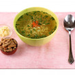 Royalty-Free Stock Photo: Tasty chicken stock with noodles on pink tablecloth