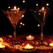 Amazing composition of candles and glasses on wooden table on bright backgr — Stock Photo #9057263