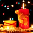 Royalty-Free Stock Photo: Wonderful candles on wooden table on bright background