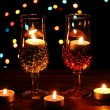 Amazing composition of candles and glasses on wooden table on bright backgr — Stock Photo