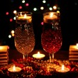 Amazing composition of candles and glasses on wooden table on bright backgr — Lizenzfreies Foto