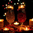 Amazing composition of candles and glasses on wooden table on bright backgr — Stock Photo #9057283