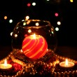 Stock Photo: Wonderful composition with candle in glass on wooden table on bright backgr
