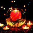 Wonderful composition with candle in glass on wooden table on bright backgr - Stock Photo