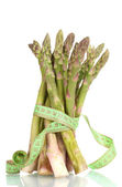 Delicious asparagus and measuring tape isolated on white — Stock Photo