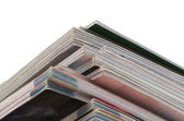 Stack of magazines isolated on white — Stock Photo