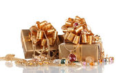 Various gold jewellery and gifts isolated on white — Stock Photo