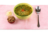 Tasty chicken stock with noodles on pink tablecloth — Foto de Stock