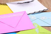 Bunch of color envelopes close-up on wooden background — Stock Photo