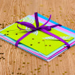 Bunch of color envelopes with ribbon and confetti on wooden background — ストック写真