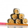 Tasty rolls with chopsticks isolated on white — Stock Photo