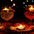 Amazing composition of candles and glasses on wooden table on bright backgr — Stock Photo #9103033