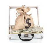 A lot of one hundred dollar bills in a case with a bag with a dollar sign i — Stock Photo