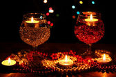 Amazing composition of candles and glasses on wooden table on bright backgr — Fotografia Stock