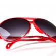 Women's red sunglasses isolated on white — Photo