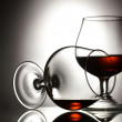 Two glasses of cognac on grey background - ストック写真