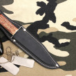 Army badges and knife on camouflage background — Stock Photo #9129597