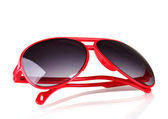 Women's red sunglasses isolated on white — Stock Photo