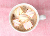 Cup of cappucino with marshmallows on pink background — Stock Photo