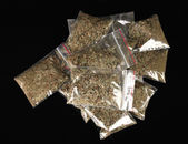 Marihuana in packages on black background — Stock Photo