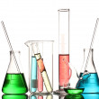 Different laboratory glassware with color liquid and with reflection isolat — Stock Photo