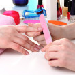 Manicure process in beautiful salon - Stock Photo