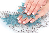 Beautiful hands and snowflakes and beads isolated on white — Stock Photo