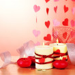 Candles for Valentine's Day on wooden table on red background — Foto Stock