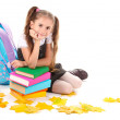 Beautiful little girl, books and a backpack isolated on white — Stock Photo