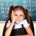 Little schoolchild in classroom near blackboard — Stock Photo #9169976