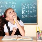 Little schoolchild in classroom near blackboard — Stock Photo #9169978