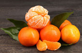 Tangerines with leaves on wooden grey table — Stock Photo