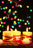 Beautiful candles and decor on wooden table on bright background — Стоковое фото