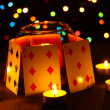 Candles and playing cards on wooden table on bright background — Stockfoto