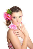 Beautiful girl with flowers in her hair isolated on white — Stockfoto