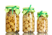 Delicious marinated mushrooms in the glass jars isolated on white — Stock Photo